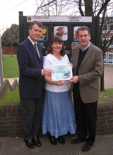 Seán Woodward, Working Group chair Rachel Hicks and Mark Hoban show the certificate of Fareham's Fairtrade status.
