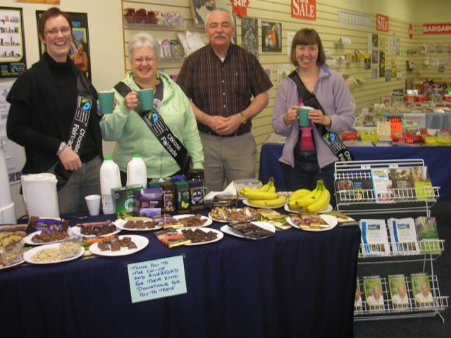 The volunteers serving tea and coffee in the shop